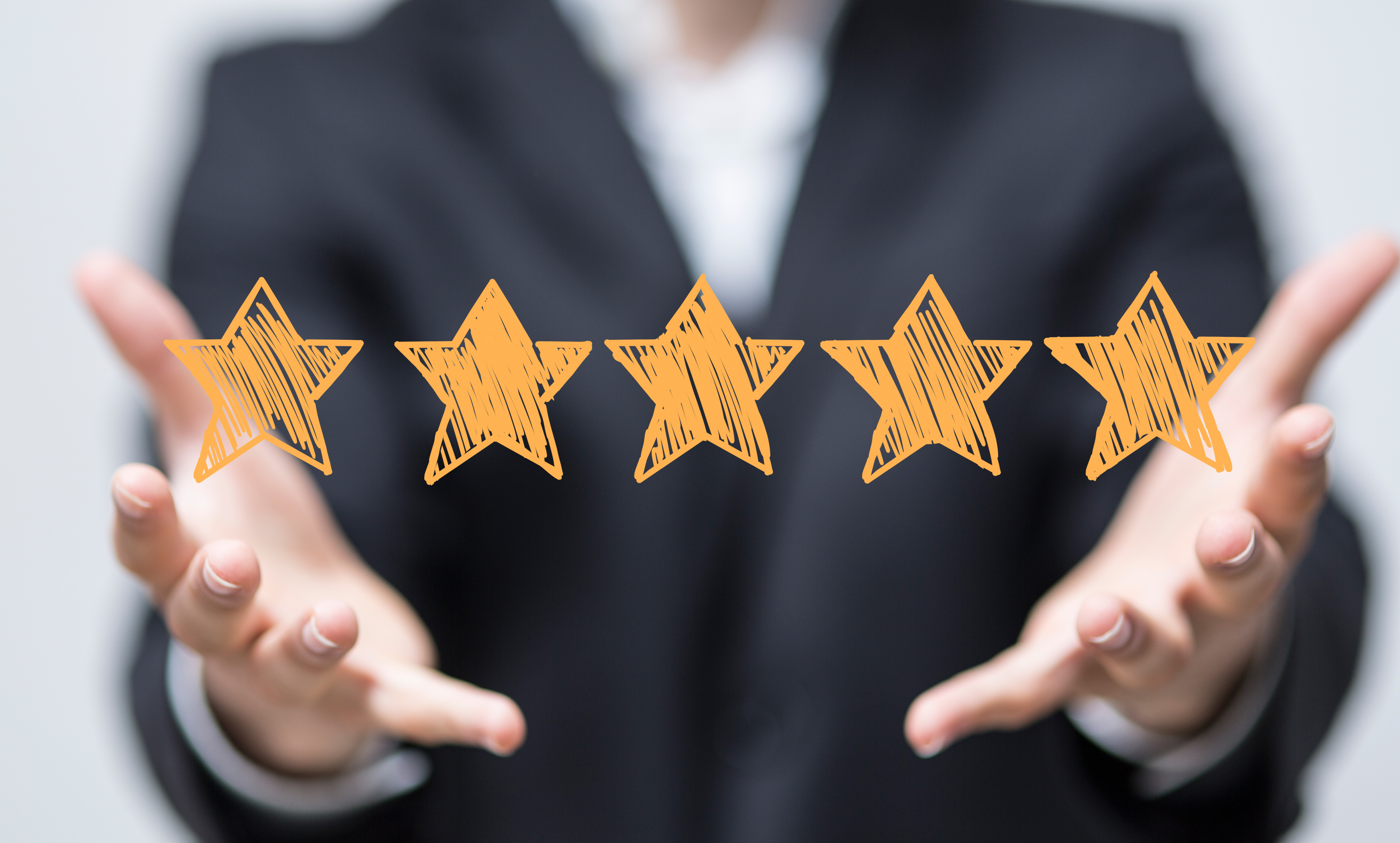 image of woman holding five stars review