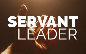 image of hand reaching out with words servant leader imposed